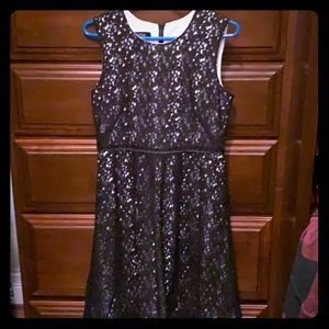 Black lace dress with white underlay. Knee length